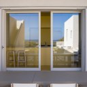 Villa in Sicily / Reflection of patio in sliding doors