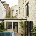 The Round House / Rear facade and pool