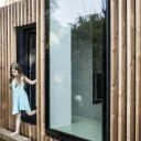 Timber fin house / Step through