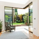 Glazed corner house / Garden room