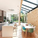 Glazed corner house / Looking through