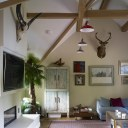 Restoration & extension to Grade II Listed house and barn conversion / Barn lounge area