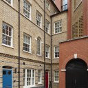 Replacement homes on Dean's Mews, London / London family homes