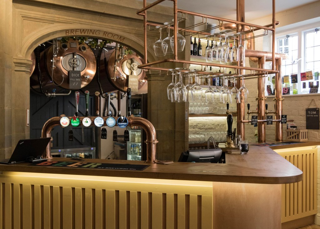 The Plough, Central Oxford / Ground floor bar showing hanging beer tanks behind