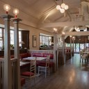 The Plough, Central Oxford / First floor restaurant with bespoke joinery booths and custom coloured light fittings
