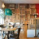 The Oxford Wine Cafe, Jericho / Cafe area, showing back wall clad in reclaimed wooden palettes