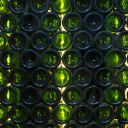 The Oxford Wine Cafe, Jericho / Detail showing recycled glass wine bottle wall behind staircase to basement