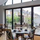ThirtyEight, Summertown Oxford / Central dining room with large windows looking out onto the private courtyard