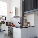 Dehavilland Studios, East London / Double height gallery over new kitchen