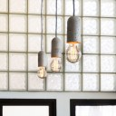 Dehavilland Studios, East London / Detail of new island pendant lights against existing glass blocks