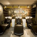 George Northwood's Hair Salon, Fitzrovia / Basement backwash showing glazed, gold tiles behind