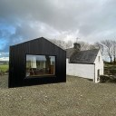 The Cottage / Extension with corrugated cladding
